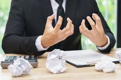 Stressed or angry businessman make a mistake with chewed paper -. Migraine or headache concept Stock Photo