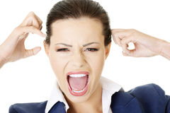 Stressed or angry businesswoman screaming loud Stock Image