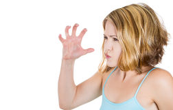 Stressed angry mad woman threatening someone with her claws , nails Stock Image
