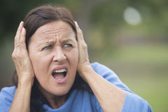 Stressed angry mature woman outdoor Royalty Free Stock Photography