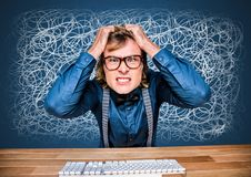 Stressed anxious man on computer with doodles scribbles on blue background. Digital composite of Stressed anxious man on computer with doodles scribbles on blue royalty free stock photo