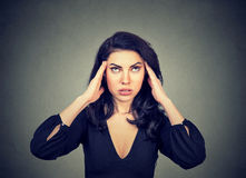 Stressed anxious young woman with headache. Stock Photography