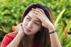 Stressed asia woman. Portrait of stressed asia woman Royalty Free Stock Photo