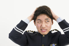 Stressed Asian Airline Pilot Stock Images