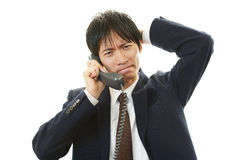 Stressed Asian businessman Stock Photo