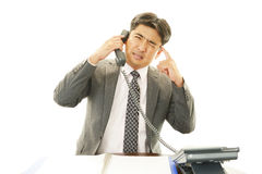 Stressed Asian businessman Stock Photography