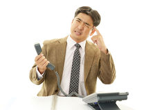Stressed Asian businessman Stock Photo