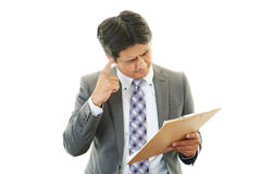 Stressed Asian businessman Royalty Free Stock Photography