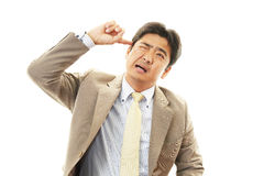 Stressed Asian businessman Stock Photos