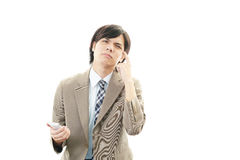 Stressed Asian businessman Royalty Free Stock Images