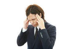 Stressed Asian businessman Royalty Free Stock Image