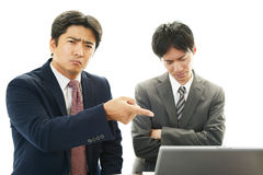 Stressed Asian businessmen Stock Image