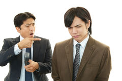 Stressed Asian businessmen Royalty Free Stock Photography