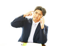 Stressed Asian businessmen Royalty Free Stock Images