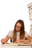 Stressed asian caucasian woman student learning in tons of books Stock Images