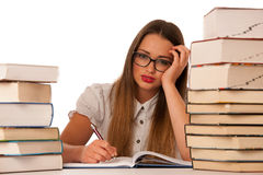 Stressed asian caucasian woman student learning in tons of books Stock Photography