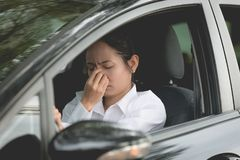 Stressed of asian woman driver sitting inside her car Royalty Free Stock Images