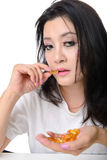 Stressed asian woman take the medicine Royalty Free Stock Photography