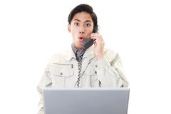 Stressed Asian worker Royalty Free Stock Images