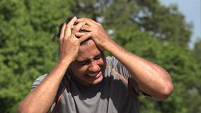 Stressed Athletic Hispanic Adult Male. A handsome adult hispanic man stock footage