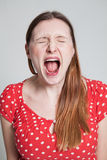 Stressed attractive woman shouting Stock Photo
