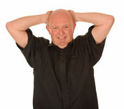 Stressed bald man. With hands on head, white background Royalty Free Stock Image