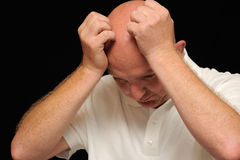 Stressed bald man. Portrait of a desperate, stressed,  bald man Royalty Free Stock Photo