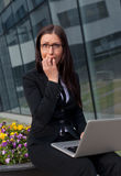 Stressed beautiful business woman biting her fingers Royalty Free Stock Images