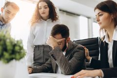 Stressed boss having problem at business meeting in office stock image