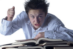 Angry boy stressed by homework Stock Photo