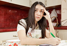 Stressed brunette making calculations Stock Image