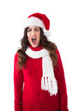 Stressed brunette in santa hat screaming Royalty Free Stock Image