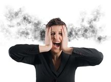 Stressed buinesswoman Stock Photo