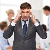Stressed buisnessman or teacher having headache Stock Photography