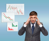 Stressed buisnessman or teacher having headache Stock Photos
