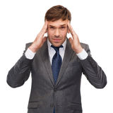 Stressed buisnessman or teacher having headache royalty free stock image