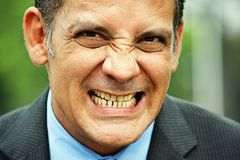 Stressed Business Executive. A handsome adult hispanic man royalty free stock photo