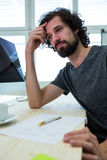 Stressed business executive at his desk. In office stock images
