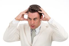 Stressed entrepreneur. Stressed business executive shocked by his problems royalty free stock photography