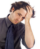 Stressed Business Man. Business man stressed with his hand on his head as if he had a headache - isolated over a white background royalty free stock images