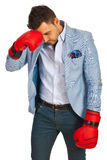 Stressed business man with boxing gloves Royalty Free Stock Photo