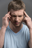 Stressed business man with headache isolated. Stock Images