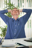 Stressed business man with a headache Royalty Free Stock Images
