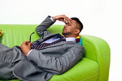 Stressed business man holding the bridge of his nose Stock Photos