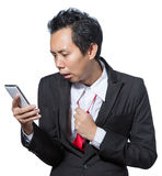 Stressed business man looking tablet Royalty Free Stock Photo