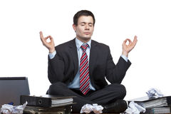 Stressed Business Man Meditates At Desk In Office Royalty Free Stock Images