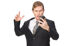 Stressed Business Man with Phone. Young business Man stressed with mobile phone. Isolated on white background stock image