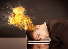 Stressed business man's head is burning Stock Images