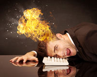 Stressed business man's head is burning Stock Image