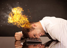 Stressed business man`s head is burning Stock Photography